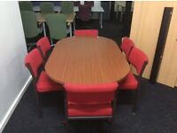 Walnut coloured conference/meeting room table and 6 red chairs