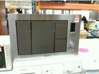 Brand New Hotpoint Integrated Microwave Oven In Silver