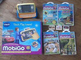 Vtech Mobigo console and 7 games and power adaptor. With original box.