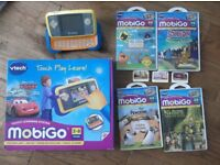 Vtech Mobigo console and 7 games and power adaptor. With original box.