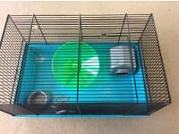 Hamster cage with bottle, bowl, house and wheel