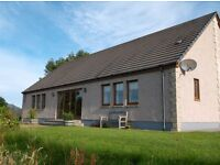 Pristine large 3-bed bungalow set in half an acre in peaceful hamlet with stunning Highland views