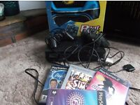 PS2 with Beat pad, 2 controllers and 4 games