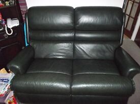 leather 2 seater sofa and 2 chairs of which 1 chair reclines