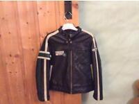 Boys leather look next jacket .