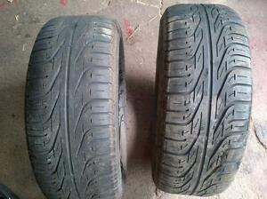 Pair of pirelli winter tires 215/55/16