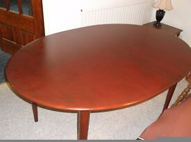 Oval Shaped Extendable Dining Room Table.