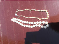 2 faux pearl necklesses