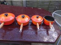 set of le creuset sausepans
