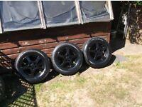 v w golf mk4 5 stud 14 inch alloy wheels x 4 , black,5 x 100 pcd ,c/w centres c/w 185/70/14 tyres