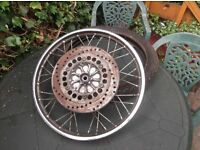 yamaha sr 125. front wheel with tire and brake cable