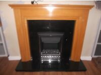 Electric fire with black marble harth and back with wood surround