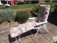 FLORAL CUSHIONED LONG SUN LOUNGER WITH GREEN STORAGE BAG
