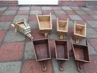 planters in the form of wheelbarrows some are made from reclamed wood