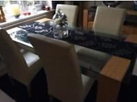 Dining table and four cream leather chairs
