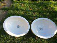 Two oval ceramic sinks used