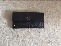 Genuine Radley black leather purse.