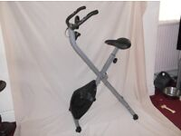 FOLDING EXERCISE BIKE USED ONCE WITH COMPUTER GREAT TO STORE IF YOU HAVE LIMITED SPACE AS NEW