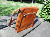 LIGHT TAN LEATHER SATCHEL, AS NEW, NEVER USED. UNISEX.