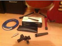 SHURE SM57 with XLR lead, spare clamp and 1/4 Neutrik adapter. Buyer to collect.