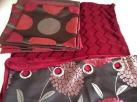 Red /brown floral eyelet curtains, red & brown circle and stripe cushions and red fleece throw
