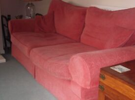 Sofa For Sale. Two seater in PERFECT condition in Terracotta colour
