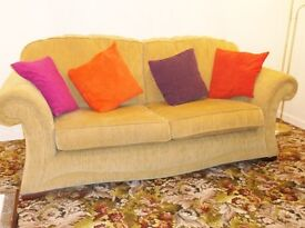 Large Comfy 2 seater sofa and 1 armchair. Can sell sofa and chairs seperately, Golden coloured