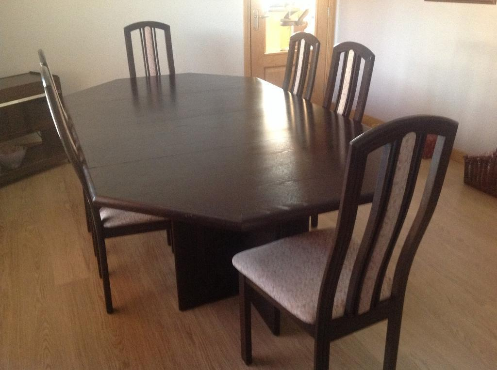 ekornes dining table and six chairs