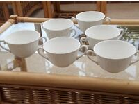 6 white ceramic bowls with handles