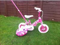 Girls first bike with stabilisers and parent handle