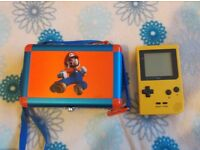 Nintendo Gameboy Pocket in yellow with Donkey Kong Land 2 and Mario hard carry case.