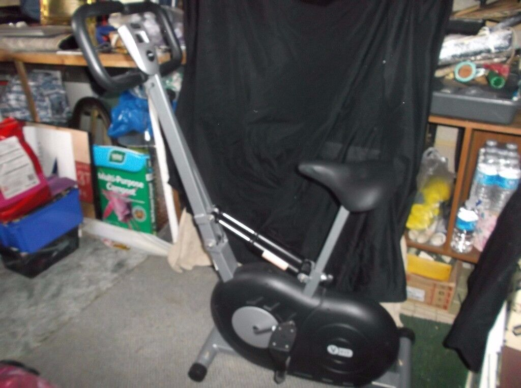 V fit exercise bike with arm strengthening feature