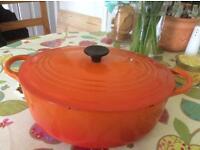 Orange Le Creuset casserole dish