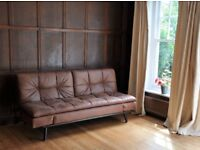 Practical 2-3 seater sofa bed - brown faux leater - multiple functions (see photographs)
