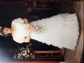 White wedding dress , off the shoulder. Full skirted
