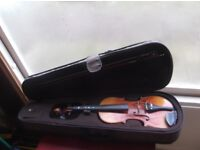 violin half sized to suit a beginner with bow and case