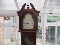 A PRETTY MAHOGANY LONGCASE GRANDFATHER CLOCK WITH WESTMINSTER CHIMES