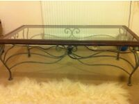 Stunning solid wood frame, glass top coffee table with heavy metal base