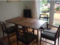 Drop leaf Dining room Table Carver and 5 chairs