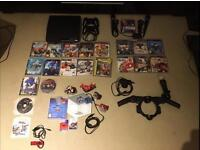 PlayStation 3 slim 500gb bundle with 2 PS Move cameras and controllers and Disney infinity