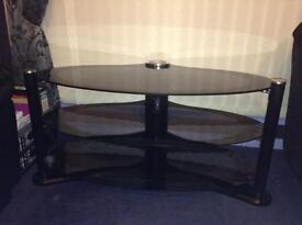 Black oval glass TV stand