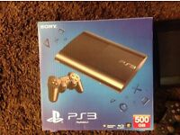 PS3 Super Slim Black in Very Good Condition Boxed 500GB With 20 Games and 2 Controllers