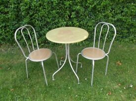 Small breakfast table and two chairs in good condition some staining on table top £15