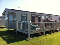 Static Caravan with beautiful sea views for holiday let / hire. Sleeps six and has a bath!