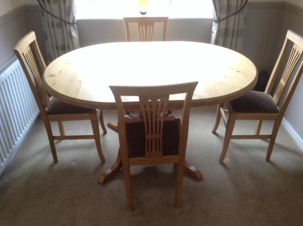 Light pine dining room table and four chairs in lower for Pine dining room table
