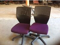 2 Purple Office Swivel Chairs
