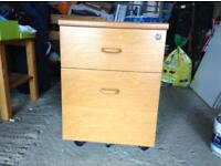 Filing cabinet in wood finish