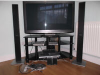 """Smoked glass tv stand, 42"""" tv is in picture"""