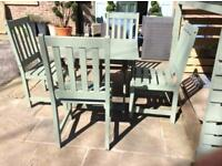Hardwood garden table and 4 chairs,