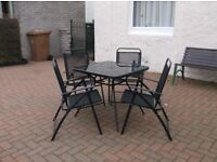 Square glass top table and 4 folding mesh chairs
